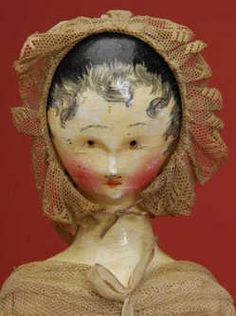 Grodner Tal Lady Doll, Austria, circa 1830, early jointed wooden doll, black painted hair with finely-painted tendrils & molded ears, painted facial features with brown eyes, fully-jointed wood body with painted lower legs & arms. Wearing original polished cotton dress with net overlay & matching bonnet.