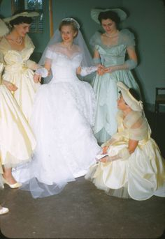 Vintage bridal party - classic white, full skirt and maids in attendance in buttercup tea length gowns with scalloped satin overlay on a tulle skirt; the maid of honor in mint. Vintage Wedding Photos, Vintage Bridal, Vintage Weddings, Romantic Weddings, Wedding Pictures, Vintage Bridesmaid Dresses, Bridal Dresses, Beautiful Bride, Beautiful Dresses