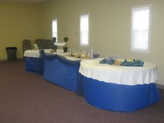 Church Anniversary Reception - 2 round tables and a rectangular one in the center. Plastic table cover used as the table skirt. Cake Table, punch table, ice cream table.
