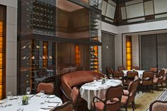 Spivak Architects - the Mark Restaurant by Jean-Georges. Main Dining Room. Upholstery, bronze & glass, skylights