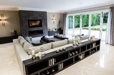 (Designed by www.lukecartledge.com) Contemporary living room with folding doors to the outside space.