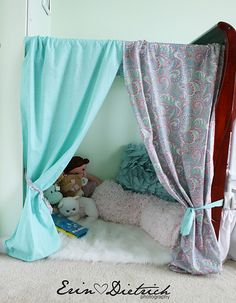 Adorable! This would totally get on my TO DO list. Just a box,curtains,pillows,toys,and a fuzzy     Rug! (Also DIY)