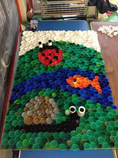 Bottle top mosaic garden scene