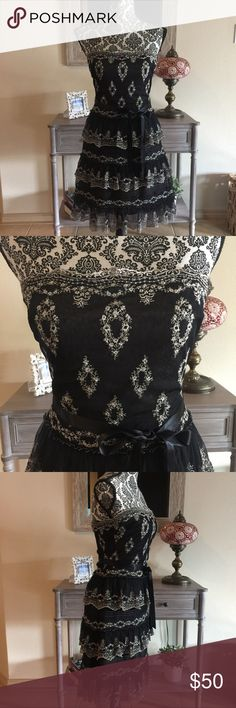 Embroidered BCBG MaxAzria Dress GORGEOUS strapless embroidered BCBG MazAzria Dress. Black with cream embroidered. Perfect for a night out or to a wedding! Skirt has multiple layers so that it flares out. Size 2! BCBGMaxAzria Dresses