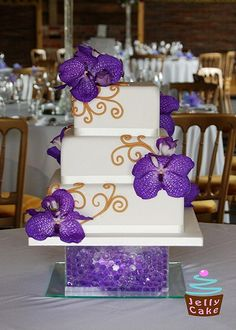 Purple Orchid Wedding Cake. Purple and gold theme would be so pretty!
