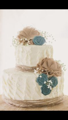 would probably nix the blue flowers but the baby's breath, burlap & twine is right up my alley