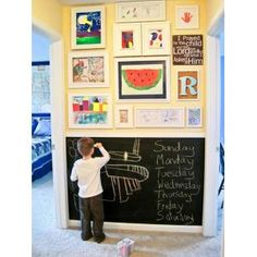Best Ideas and Products to Keep The Playroom Organized by Eden Godsoe... like the chalkboard paint wall