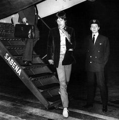 March 6, 1967. Mick Jagger, on his return flight home from Brussels, when he was met by Marianne Faithfull. ♥ #RollingStones #KeithRichards #BrianJOnes #RonnieWood #CharlieWatts #MickJagger