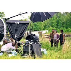 Behind the scenes of The Walking Dead's Entertainment Weekly cover shoot - Photographer @danwintersphoto and actors Andrew Lincoln, Melissa McBride, and Norman Reedus out standing in the field.