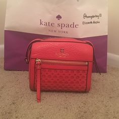 Kate Spade Perri Lane Looloo This is an authentic Kate Spade Perri Lane Lulu in the color orange. This has been used, but is in good condition. There is are two slight marks on the back of the bag in the third picture. kate spade Bags Crossbody Bags