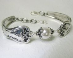 This highly detailed, but delicate spoon bracelet was created from two vintage teaspoons. The pattern is the beloved Silver Belle from 1940. Its