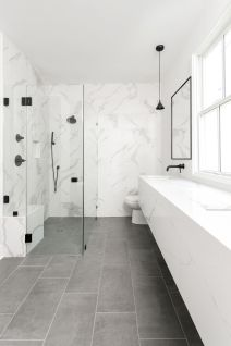 Modern bathroom with quartz floating vanity, matte black wall-mount faucets & fi. Modern bathroom with quartz floating vanity, matte black wall-mount faucets & fixtures and curbless White Marble Bathrooms, Small Bathroom, Bathroom Black, Bathroom Ideas, Bathroom Showers, Bathroom Organization, Marble Tile Bathroom, Bathroom Things, Marble Showers