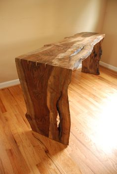 Live edge Walnut console table.  See more custom live edge wood at www.frisonloguehardwoods.com