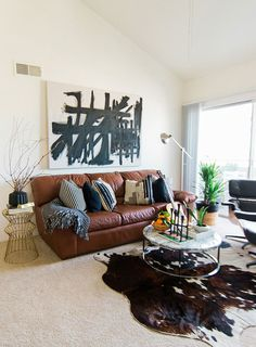 The painting that overlooks this living room was a DIY project Ashley tackled. First, she had a larger-than life canvas constructed at The Home Depot. She then channeled her inner Franz Kline and let loose on the blank surface.