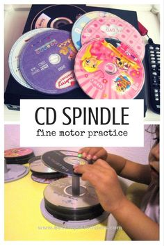 Best Toys 4 Toddlers - Using unlikely toys like CDs and DVDs for a bit of fine motor practice with toddlers