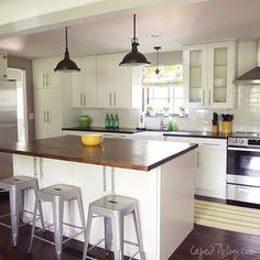 They took down walls between kitchen and family room, love the open look! Also the Ikea white cabinets and butcher block counter top on the island. Amazing before and after pictures, all for under 1oK