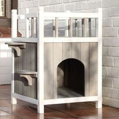 Features: -Material: Weather-treated non-toxic fir wood and metal. -Ideal for cats and small dogs. -Includes condo with side steps and balcony with latticework. Product Type: -Cat house. Dimension