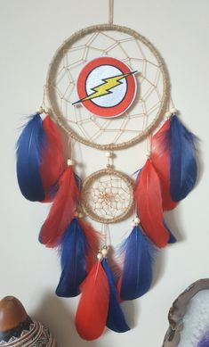 Flash DC Dream Catcher, Super Hero Dreamcatcher Wall Hanging Measurements: Dreamcatcher ring 6 inches ( 15cm.) 21 inches length ( including cotton hanger) MATERIALS: metal hoops wrapped in natural color jute cord, tan string, ivory wooden beads, red and blue goose feathers, embroidered flash DC Dream Catcher Decor, Black Dream Catcher, Large Dream Catcher, Dream Catcher Boho, Dream Catchers, You Are My Superhero, Superhero Gifts, Boho Tapestry, Tapestry Wall Hanging