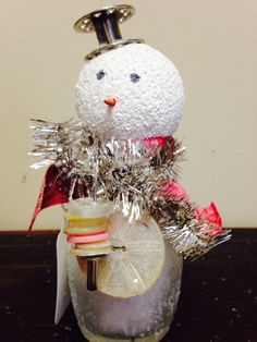 Sweet snowman made out of a salt shaker. Love the bobbin hat and button scarf.