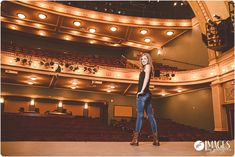 Such a cool senior portrait shot of this thespian on stage!  Images by Jennifer Grand Rapids Senior Photographer  Awesome Senior Pictures
