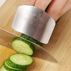 - High-quality guard that protects fingers while slicing and dicing - Material: Stainless steel - Color: Chrome - Size: 2.46x1.95 inches - Ring Diameter: 0.7inches (adjustable) - Wear on to the middle