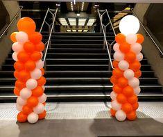 Standard orange and white balloon columns