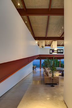 Located in Nova Lima, Brazil, this contemporary two-storey private residence was designed for an art collector by Denise Macedo Arquitetos Associados
