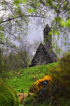 The ancient ruins of Glendalough church in Ireland appear out of the mists of the Emarald Isle.