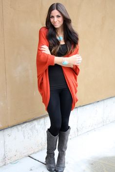 Red cardigan, teal necklace