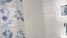 Bring a piece of #nature into your #bathroom with our decorated #tiles