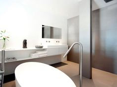 COCOON showroom in Amsterdam bycocoon.com | modern inox stainless steel bathroom taps & fittings | solid white freestanding bathtub & washbasin | all available via our website | modern bathroom design | villa design | hotel design | interior design projects | Dutch Designer Brand COCOON