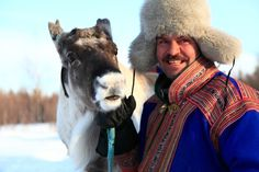 Man with #reindeer in Lapland.