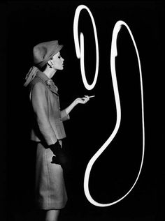 Dorothy blowing light smoke rings, Paris 1962* by William Klein
