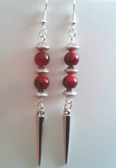 Handmade Jewellery - Earrings 3.50. A gift idea by Jean Wilson found on www.MyOwnCreation.co.uk: These earrings are made with blood red glass beads, Tibetan silver beads as spacers and acrylic spikes dangling from the bottom of the earrings. The earring hooks are silver plated. Length 3.5ins. Your earrings will come in a small organza gift bag(colours will vary)
