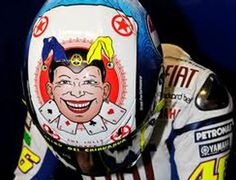 The Minichamps Valentino Rossi AGV Helmet Mugello Jolly Joker 2010, is a copy of Valentino Rossi's motorcycle helmet from 2010.    Add this superb 1/8 scale replica helmet to your collection today!!