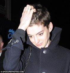 Hair we go! Anne Hathaway lops her flowing brunette locks into a choppy short style for Les Miserables role