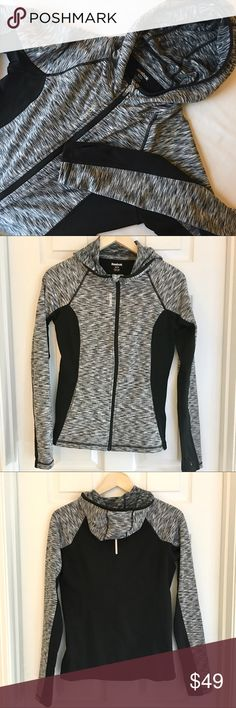 """{Reebok} Athletic Zip Up Hoodie Size Small Reebok Athletic Zip Up Hoodie Track / Running Jacket in charcoal black and white. Size Small.  Two inner pockets.  Machine washable.  Fabric is 95% Poly, 5% Spandex.  Measurements: 24"""" long and 17"""" bust armpit to armpit zipped laying flat. EUC! Reebok Tops Sweatshirts & Hoodies"""