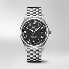 This compact timepiece upholds the tradition of the iconic Mark XI and reduces the functionality and design of a typical Pilot's Watch to absolute essentials. Iwc Watches, Watches For Men, Stainless Steel Bracelet, Stainless Steel Case, Iwc Chronograph, Matte Black Background, Iwc Pilot, Watch Companies, Automatic Watch