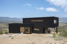 Architect Thomas Löwenstein has designed this black wooden house near Los Molles in Chile. Situated on a hillside near the beach town of Los Molles in Building A Container Home, Container House Design, Casa Santa Rita, Ohio House, Italian Farmhouse, Casas Containers, Modern Pools, Exterior House Colors, Black House