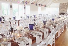 A very unique idea for a wedding on Cape Cod! This was set up for a clam bake wedding reception at the Vineyard Haven Yacht Club. Long banquet tables also seem to be the trend these days ... © Dreamlove Photography
