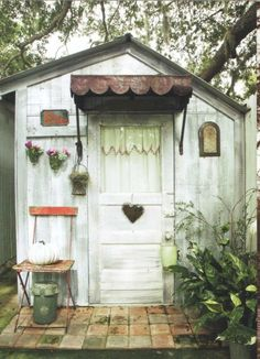 Beautiful little garden shed with tin awning over door