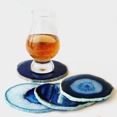 Keep the coffee rings off your desk by using a pretty agate coaster under your mug of brew. | 22 Ways To Make The Office Your Happy Place