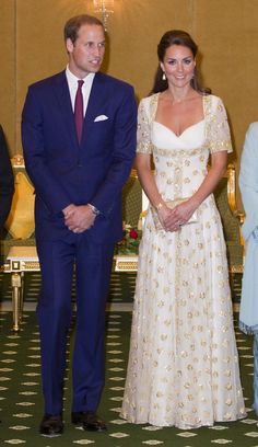 Kate stunned in a white and gold gown at a dinner in Southeast Asia.