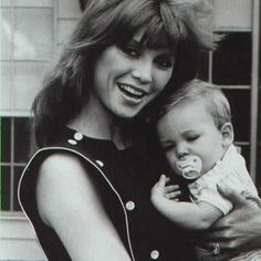 pam and baby christopher. christopher james ewing was played by eric farlow and joshua harris