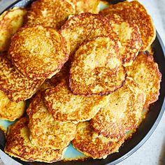 GRANDMA'S POLISH POTATO PANCAKESMy grandma made the most delicious Polish potato pancakes I've ever tasted. They were crispy-skinned fresh off the pan, yet very soft and delicate inside. Customary to how potato pancakes are made in Poland and Potato Dishes, Potato Recipes, Polish Potato Pancakes, Polish Recipes, Polish Food, Shredded Potatoes, Ukrainian Recipes, Tasty, Yummy Food