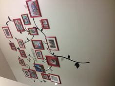 After.....photo wall :) frames from family dollar, two cans of red spray paint, wall art from Walmart and voila!