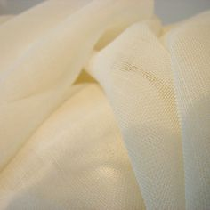 Wool Gauze Fabric. You're right. It's not yarn. And it's not silk. But it's the most amazing wool gauze fabric. It collapses into scrumptious pleats when you wash it in hot water. http://www.sanjosilk.com/wool-gauze-fabric/