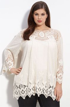 Romantic crochet lace trims the front yoke, sleeves and hem of a layering tunic fashioned in open-weave knit. Plus size