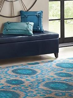 Your guests will be mesmerized by the beautiful blue display the Siam Area Rug puts on in your home.