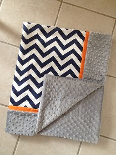 Hey, I found this really awesome Etsy listing at http://www.etsy.com/listing/176248381/baby-blanket-navy-chevron-grey-minky-dot